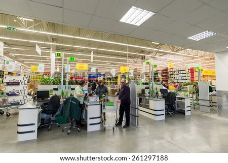Moscow russia march 14: people pay for goods at the checkout in