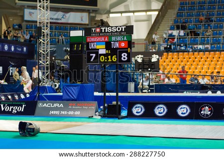 MOSCOW, RUSSIA - MAY 31 2015: A. Komashuk and A. Besbes score board on the World  fencing Grand Prix Moscow Saber in Luzhniki sport palace