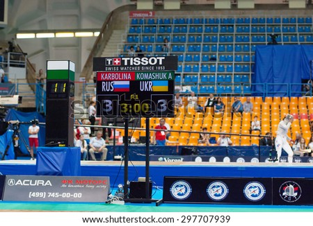 MOSCOW, RUSSIA - MAY 31 2015: A. Komashuk and E. Karbolina score board on the World  fencing Grand Prix Moscow Saber in Luzhniki sport palace