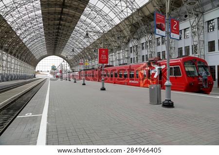 MOSCOW, RUSSIA - MAY, 14 2015: Aeroexpress red Train on Kiyevskaya railway station  (Kiyevsky railway terminal,  Kievskiy vokzal) -- is one of the nine main railway stations of Moscow, Russia