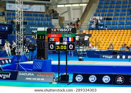 MOSCOW, RUSSIA - MAY 31 2015: C. Shen and F. Palu score board on the World  fencing Grand Prix Moscow Saber in Luzhniki sport palace