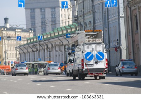 MOSCOW, RUSSIA - MAY 6: Car is measuring the quality of the road after the passage of military vehicles on the streets after the rehearsal of the Victory Day Parade on May 6, 2012 in Moscow, Russia.