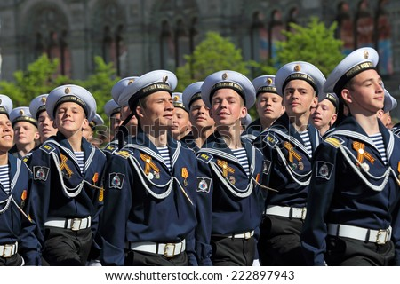 MOSCOW, RUSSIA - MAY 09, 2014: Celebration of the 69th anniversary of the Victory Day (WWII). Solemn marching of soldiers in Red Square. The cadets of the St. Petersburg Sea Cadet Corps