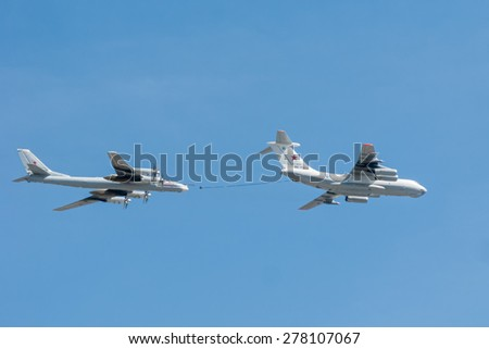 MOSCOW/RUSSIA - MAY 7: Il-78 (Midas) aerial tanker and Tu-95MS (Bear) large strategic bombers and missile platform demonstrate refueling on parade devoted to Victory Day on May 7, 2015 in Moscow.