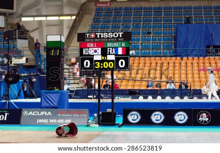 MOSCOW, RUSSIA - MAY 31 2015: Jiyeon Kim and Manon Brunet score board on the World  fencing Grand Prix Moscow Saber in Luzhniki sport palace