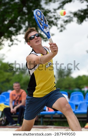 MOSCOW, RUSSIA - MAY 31, 2015: Nikolay Guriev in the match of Russian beach tennis championship. 120 adults and 28 young athletes compete in the tournament