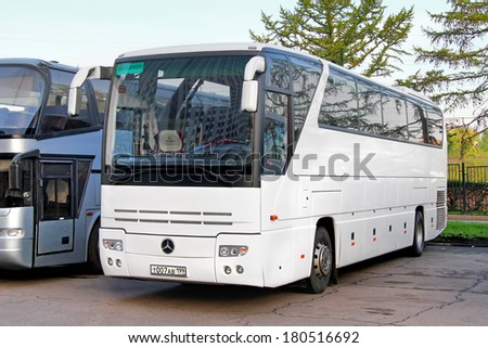 MOSCOW, RUSSIA - MAY 5, 2012: White Mercedes-Benz O350SHD Tourismo interurban coach at the city street.