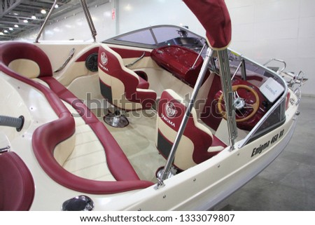 Moscow / Russia – 03 07 2019: Motor boat Enigma 490 BR on Russian yacht exhibition Moscow Boat show MBS 2019 in Crocus Expo - view to cockpit  #1333079807