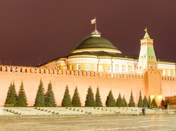 Moscow, Russia. Night view of The Moscow Kremlin: Red square,wall, Senate palace, Senate tower. Russian flag