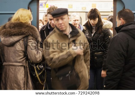 MOSCOW, RUSSIA - NOVEMBER 26, 2008: People in a train station of Moscow metro at November 26, 2008, in Moscow, Russia #729242098