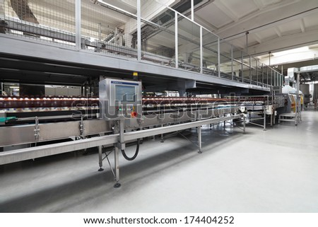 MOSCOW, RUSSIA, OCHAKOVO BREWERY - JUN 13, 2013: The biggest Russian company beer and beverage industry. Finished products - beer in plastic bottles moving on conveyor