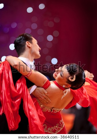 "MOSCOW, RUSSIA - OCTOBER 04: An unidentified dance couple in a dance pose during World Dance Cup PRO-AM, Russian Championships ""Autumn Star"" October 04, 2009 in Moscow, Russia."