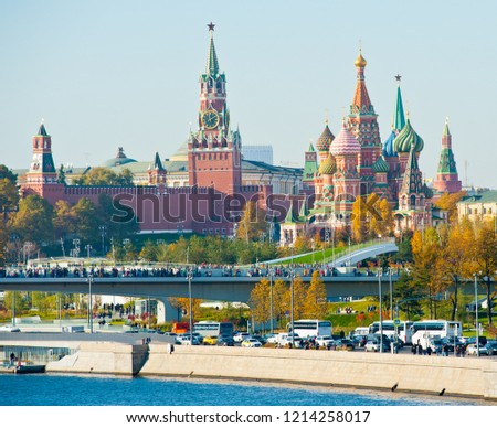 "MOSCOW, RUSSIA - OCTOBER 13, 2018: The ""floating bridge"" in the park ""Zaryadye"". Spasskaya Tower and Cathedral of Vasily the Blessed (Saint Basil's Cathedral) on Red Square in sunny autumn day"