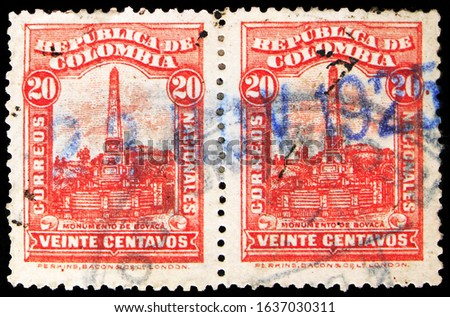 MOSCOW, RUSSIA - OCTOBER 8, 2019: Two postage stamps printed in Colombia shows Monument to Battle of Boyaca, Personalities, Arms and City Views serie, circa 1917