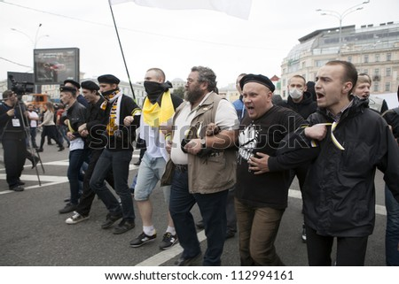 MOSCOW , RUSSIA - SEPT 15. Tens of thousands of opposition supporters have marched through Moscow in the first major protest against President Putin in three months on September 15, 2012, Moscoww
