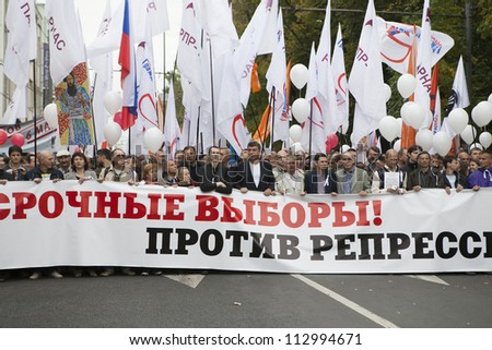 MOSCOW , RUSSIA - SEPT 15. Tens of thousands of oppositionist marched through Moscow in  against President Putin. Nemtsov  is  Russian politician between protestant. on September 15, 2012, Moscow