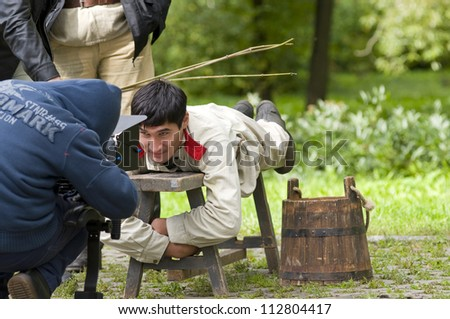 MOSCOW, RUSSIA - SEPTEMBER 9: Unidentified actors on the set of cinema film based on the works of Russian writer Kuprin September 9, 2012 in Moscow, Russia. - stock photo