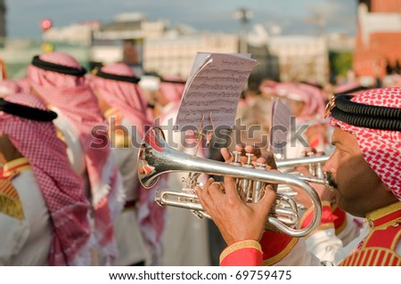 "MOSCOW - SEPTEMBER 4: Band of Police of the Kingdom of Bahrain act at the international military-musical festival ""Spassky Tower"" on September 4, 2010, on Red Square in Moscow - stock photo"