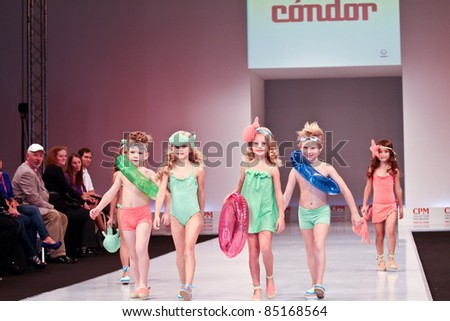 MOSCOW - SEPTEMBER 7: Collection of clothing CONDOR at the international exhibition of  the fashion industry, Collection Premiere Moscow, CPM on September 7, 2011 in Moscow. Unidentified children