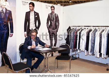 MOSCOW - SEPTEMBER 7: Man presents a collection of clothes at the international exhibition of  the fashion industry, Collection Premiere Moscow, CPM on September 7, 2011 in Moscow