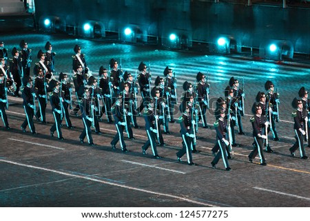 MOSCOW - SEPTEMBER 4: Orchestra of the Royal Guard of His Majesty and ceremonial platoon Norway at Military Music Festival Spasskaya Tower on September 4, 2011 in Moscow, Russia. #124577275
