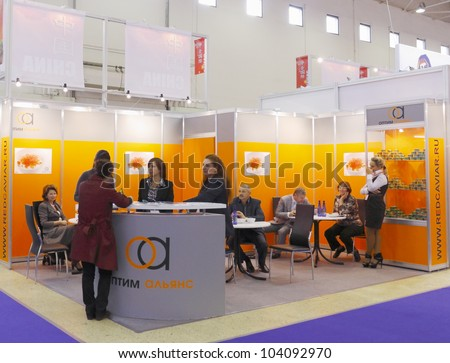 MOSCOW-SEPTEMBER 13: The stand of the Russian company OPTIM ALYANS specializes in the wholesale seafood delicacies at International Food & Drinks Exhibition on September 13, 2011 in Moscow - stock photo