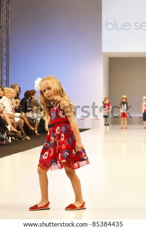 MOSCOW-SEPTEMBER 5:unidentified model walks down the runway wearing German brand Blue Seven collection premiere Moscow Kids at  the International Fashion Fair on September 5, 2011 in Moscow, Russia.