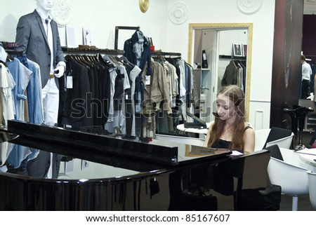 MOSCOW - SEPTEMBER 7: Unidentified woman plays the piano at the international exhibition of  the fashion industry, Collection Premiere Moscow, CPM on September 7, 2011 in Moscow