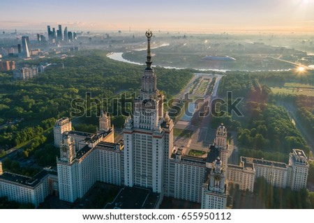 Moscow state university and Moscow city business center at sunrise. City in fog. Russia. Aerial View. #655950112