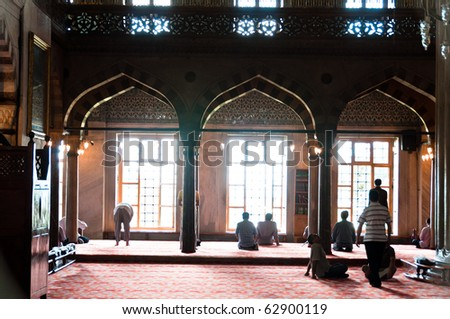 Moslems performing their prayer in the gorgeous Blue Mosque in Istanbul, Turkey
