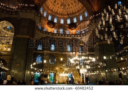 Moslems performing their prayer in the gorgeous Yeni Camii mosque in Istanbul, Turkey
