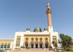 Mosque and minaret in Niamey, Niger. Travel to Niamey in Niger, West-Africa. Lifestyle of people in Sahara and Sahel near the Niger River.
