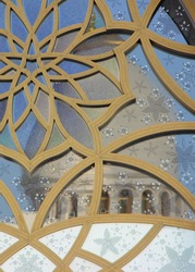 Mosque Dome Reflected in a Window with a Flower Pattern in the Middle East