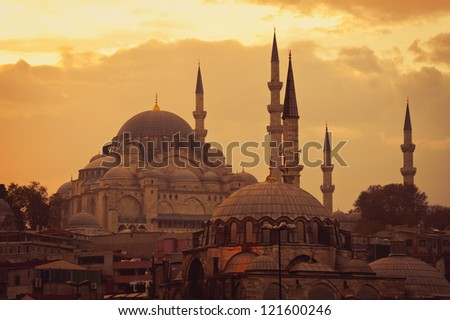 Mosque in Istanbul at sunset. The view from the Galata Bridge