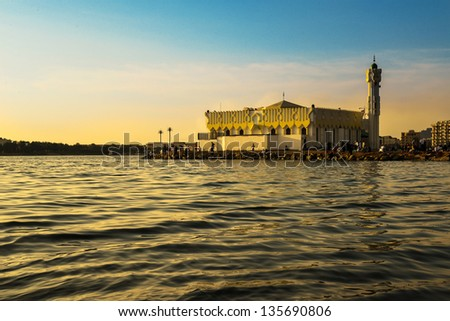Mosque in jeddah beach at sunset & people around it