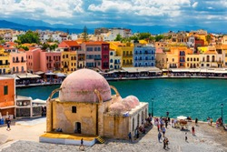 Mosque in the old Venetian harbor of Chania town on Crete island, Greece. Old mosque in Chania. Janissaries or Kioutsouk Hassan Mosque in Chania Crete. Turkish mosque in Chania bay. Crete, Greece.
