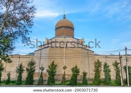 Mosque Namazgoh surrounded by trees, Samarkand, Uzbekistan. Traditional crescent on dome. Built in XVII by benefactor Nadir Divanbegi Stock photo ©