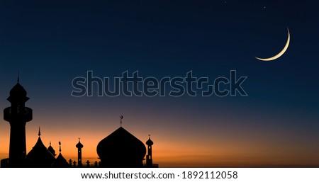 Mosques dome on dark blue twilight sky and crescent moon on background, symbol Islamic religion and free space for text arabic, Ramadan, Eid al-Adha, Eid al-fitr, New year Muharram.