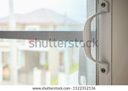 mosquito net wire screen on house window protection against insect #1122352136