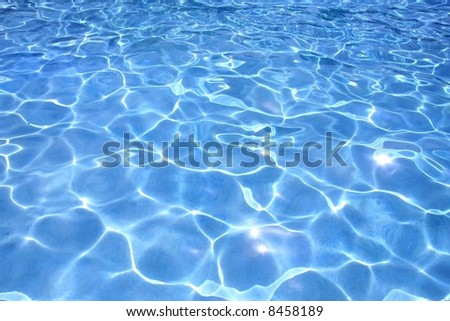 Most beautiful clear pool water reflecting in the sun