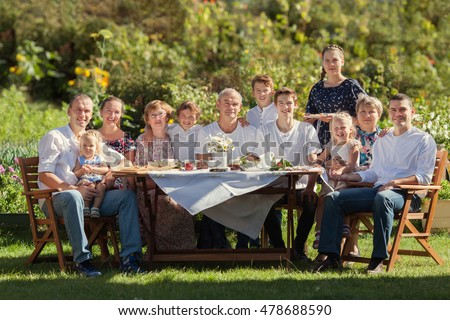 Most beautiful happy family in garden, portrait of three generations, outdoor