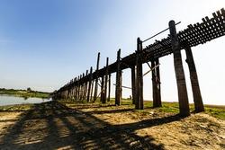Most famous fantastic landmark world longest wooden U Bein bridge with beautiful clear blue sky , popular photographers attraction in Amarapura , Myanmar