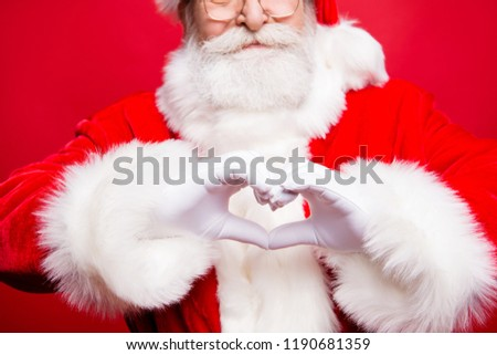 Most heartfelt newyear congratulations! Cropped close up photo of Saint Nicholas hands show heart with fingers isolated on vivid red background