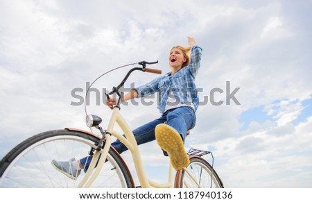 Most satisfying form of self transportation. Cycling gives you feeling of freedom and independence. Girl rides bicycle sky background. Freedom and delight. Woman feels free while enjoy cycling.