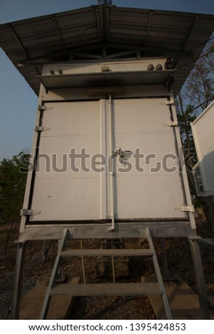Most telecom equipment cabinets are installed on the side of telecommunication towers.
