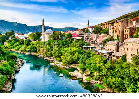 Mostar, Bosnia and Herzegovina. Morning sun on Nerteva River and Old City of Mostar, with Ottoman Mosque #480358663
