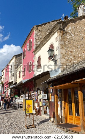 MOSTAR, BOSNIA AND HERZEGOVINA- SEPTEMBER 24: Tourists Perusing the Colorful Shops in the Old Town On September 24, 2010 in Mostar, Bosnia and Herzegovina