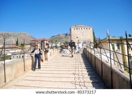 MOSTAR, BOSNIA - SEPTEMBER 17: The restored Old Bridge on September 17, 2008 in Mostar, Bosnia. The symbol of Mostar destroyed in the war, but rebuilt with the help of UNESCO. World Heritage site.
