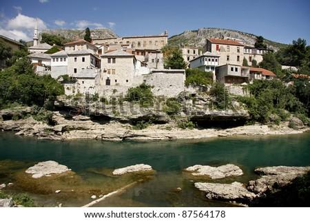 Mostar city seen from the river Neretva near The Old Bridge