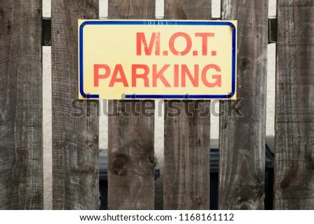 MOT parking sign on fence at garage car park Stockfoto ©